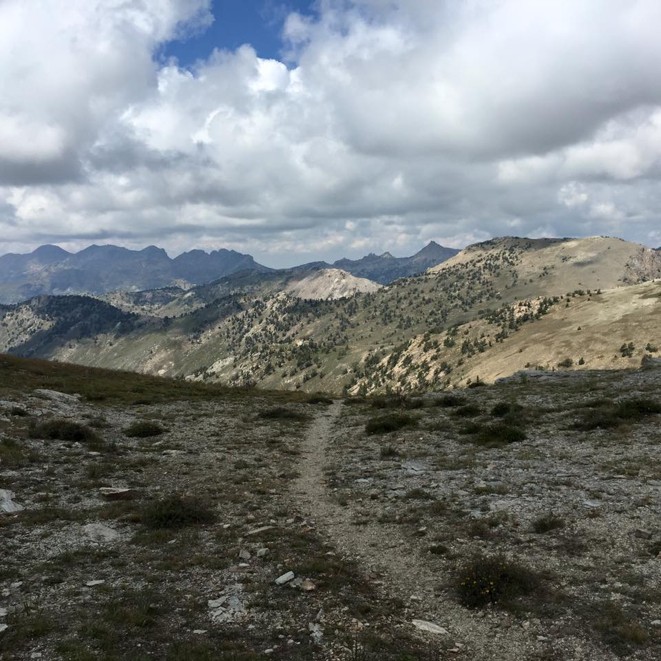 Runners enjoying the view of the Ruby Crest Trail after the clouds part and reveal a panoramic landscape.