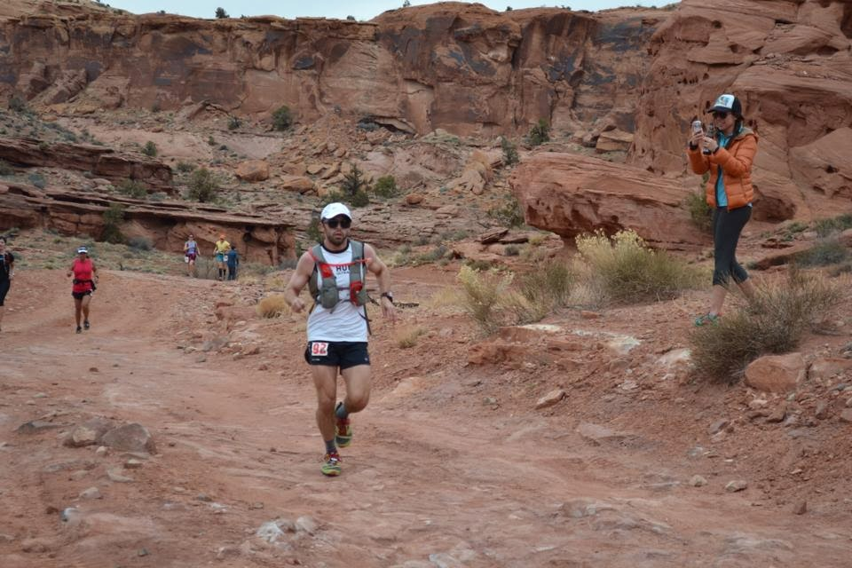 Male ultra runner competing in the Moab Red Hot 55k trail race.
