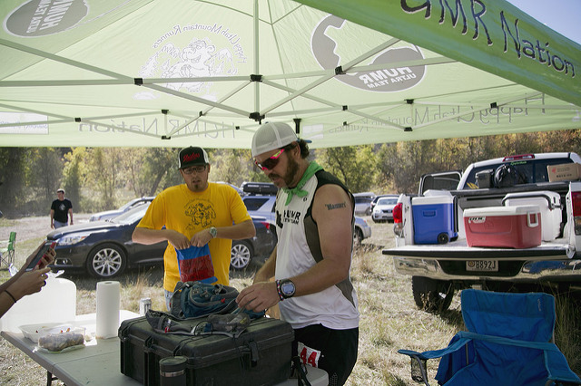 Aric Manning stopping at Leathum Hollow Aid Station during the 2013 Bear 100 ultra race.