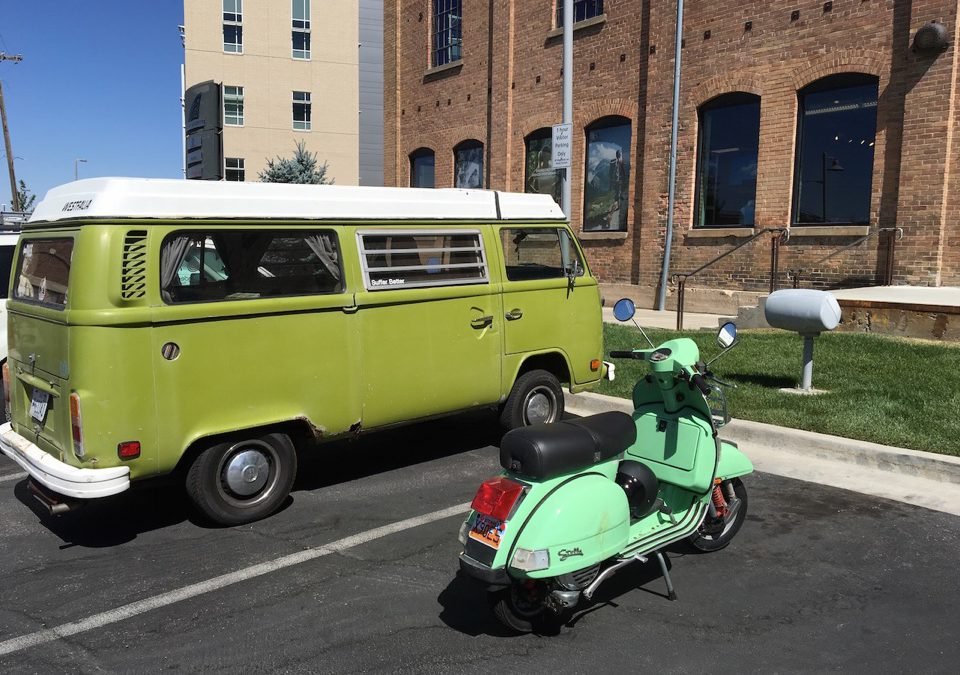 Image of Stephanie Gardner's Scooter next to the TrailManners VW Bus.