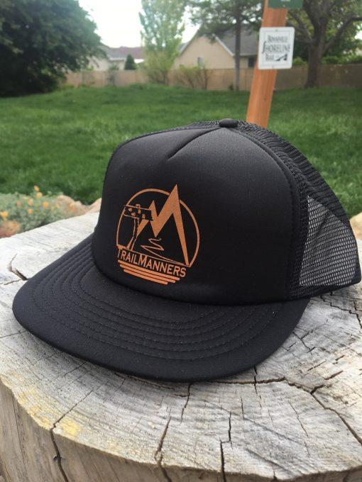 Black Trucker hat with orange TrailManners logo