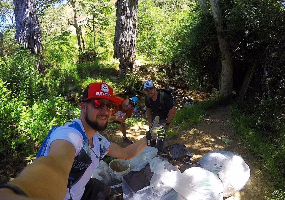 Michael Laymon from the Trail Initiative collecting trash on the San Diego trails.