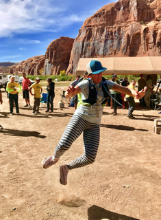 Sylvia Greer jumping for joy at the Moab240 finish