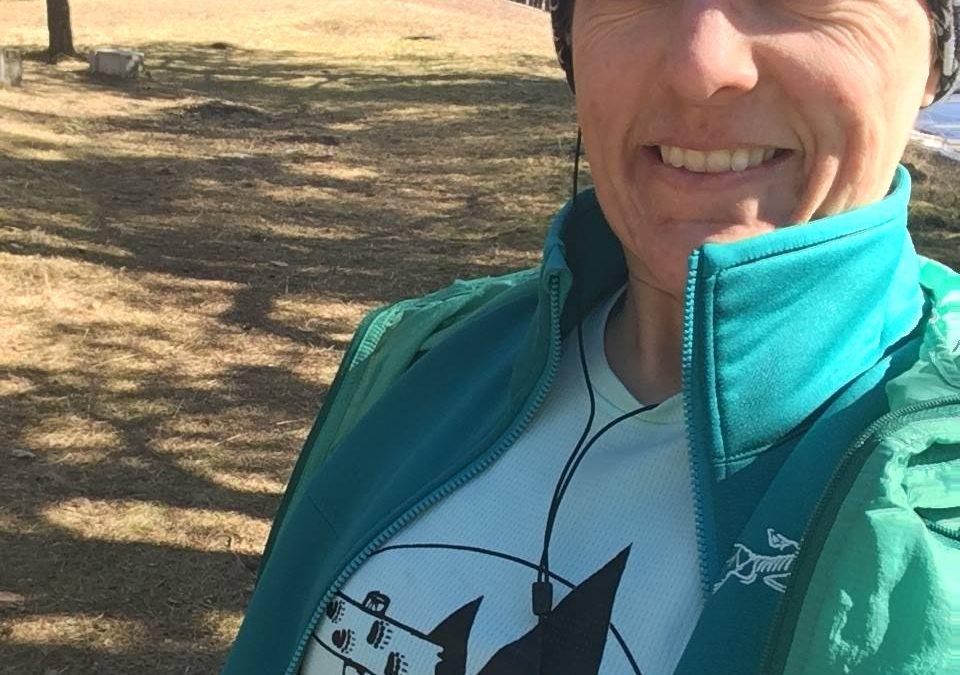 Trail runner, Amy Pett, stops along the trail in Estonia.