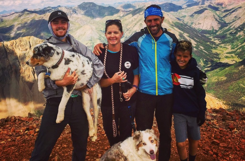Ultra Runner Scott Jamie and his family standing on a mountain top.